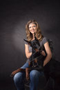 Woman with dobermann dog on black background Royalty Free Stock Photography