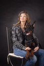 Woman with dobermann dog on black background Royalty Free Stock Photos
