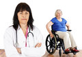 Woman doctor and handicap senior friendly women looking at camera with in wheelchair in the back Stock Image