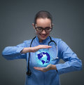 The woman doctor holding earth in globalisation concept