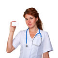 Woman doctor holding white card Royalty Free Stock Photos
