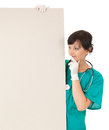 Woman doctor looking at blank placard white background Royalty Free Stock Image