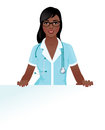 Woman doctor in medical uniform holding a blank white billboard Royalty Free Stock Photo