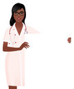 Woman doctor in medical uniform holding a blank white board Royalty Free Stock Photo