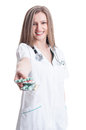 Woman doctor offering blisters of pills beautiful and various friendly medic concept on white background Stock Image
