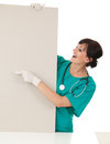 Woman doctor pointing on blank board white background Royalty Free Stock Images