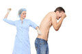 Woman doctor puts a prick. The man is afraid and Royalty Free Stock Photo