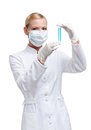 Woman doctor in respirator hands vial with liquid Stock Images