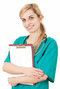 Woman doctor with stethoscope keeping clipboard Stock Photos