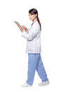 Woman doctor using tablet pc and walking Royalty Free Stock Photo