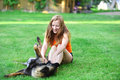 Woman with dog playing on grass Stock Photos