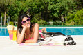 Woman and dog on summer at swimming pool sunbathing relaxing together funny beautiful girl her pet wearing sunglasses Royalty Free Stock Photo