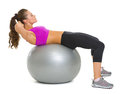 Woman doing abdominal crunch on fitness ball