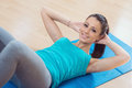 Woman doing abs workout at gym Royalty Free Stock Photo