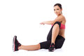 Woman doing body twist exercises Royalty Free Stock Image