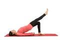Woman doing bridge pose with leg extension Royalty Free Stock Photo