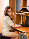 Woman doing business paperwork at home Royalty Free Stock Photo