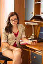 Woman doing business paperwork at home Royalty Free Stock Image