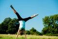 Woman doing cartwheel in a field Royalty Free Stock Photo