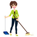 Woman doing chores sweeping floor broom dustpan Stock Image