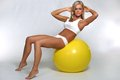 Woman doing crunches on fitness ball a blonde abdominal a Stock Images