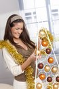 Woman doing design christmas decoration laughing young garland and stylish modern tree Stock Photos