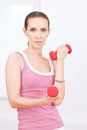 Woman doing dumbbell exercise at sport gym Royalty Free Stock Image