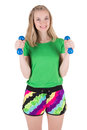 Woman doing exercise with blue dumbbells in sportswear Royalty Free Stock Photo
