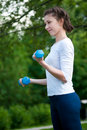 Woman doing  exercise with dumbbell Royalty Free Stock Photos