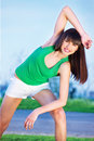 Woman doing exercise outdoors Stock Photography