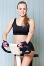 Woman doing exercise on training apparatus Royalty Free Stock Image