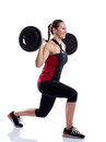 Woman doing exercise with a weight isolated over white background Royalty Free Stock Photo