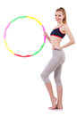 Woman doing exercises with hula hoop Royalty Free Stock Photography