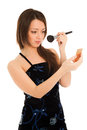 Woman doing her make up isolated on white Stock Images