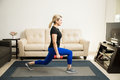 Woman doing kneeling lunges at home Royalty Free Stock Photo