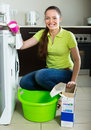 Woman doing laundry at home Royalty Free Stock Photo
