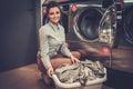 Woman Doing Laundry At Laundro...