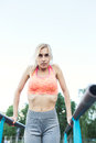 Woman doing lifting up on the gym bar. young fitness girl pulls up on street sport gym. Royalty Free Stock Photo
