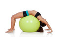 Woman doing pilates with a ball exercise isolated on white background Stock Photos
