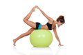 Woman doing pilates with a ball exercise isolated on white background Royalty Free Stock Photography