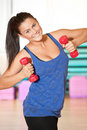 Woman doing power exercise at sport gym Royalty Free Stock Image