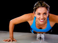 Woman doing push-ups Royalty Free Stock Photography