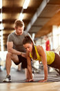 Woman doing pushups with assist Royalty Free Stock Photo