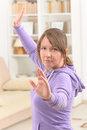 Woman doing qi gong tai chi exercise beautiful at home Stock Photos