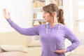 Woman doing qi gong tai chi exercise beautiful at home Royalty Free Stock Photography