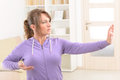 Woman doing qi gong tai chi exercise beautiful at home Royalty Free Stock Image