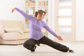 Woman doing qi gong tai chi exercise beautiful at home Stock Image