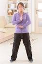 Woman doing qi gong tai chi exercise beautiful at home Stock Photo