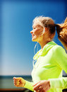 Woman doing running outdoors sport and lifestyle concept Royalty Free Stock Photos