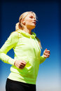 Woman doing running outdoors sport and lifestyle concept Royalty Free Stock Photography